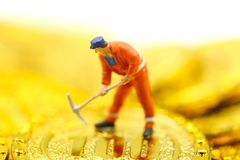 Miniature people : worker digging on gold coins. Miniature people : worker digging on gold coins stock photos
