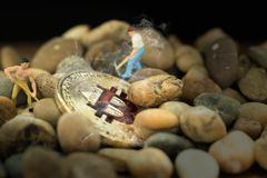Miniature people worker digging golden bitcoin on pebbles. Virtual cryptocurrency mining, Electronic money exchange, Mining. And trading, Finance, Payment stock photos