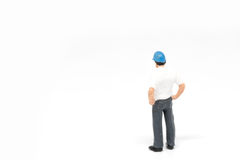 Miniature people worker safety construction concept on white bac Stock Image