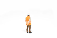 Miniature people worker safety construction concept on white bac Royalty Free Stock Images