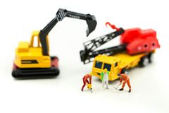 Miniature people : worker team for building home ,Image use for stock images