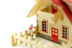 Miniature people : worker team for building home ,Image use for construction, business concept,house repair or home renovating.  stock image