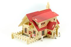 Miniature people : worker team for building home ,Image use for construction, business concept,house repair or home renovating.  royalty free stock photos