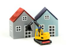 Miniature people : worker team for building home ,Image use for construction, business concept,house repair or home renovating.  royalty free stock photo