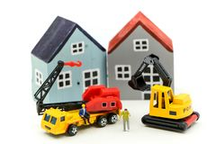 Miniature people : worker team for building home ,Image use for construction, business concept,house repair or home renovating.  royalty free stock image