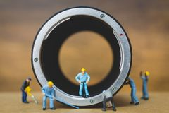 Miniature people : Worker team checking The pipe Royalty Free Stock Photos