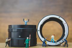 Miniature people : Worker team checking The pipe Stock Photo