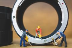 Miniature people : Worker team checking The pipe Stock Photography