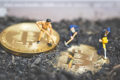 Miniature people : Worker team digging ground to uncover big shi. Ny bitcoin ,  Successful work concept Stock Photography