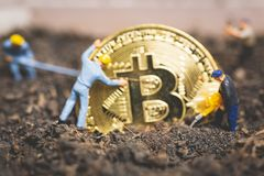 Miniature people : Worker team digging ground to uncover big shi. Ny bitcoin ,  Successful work concept Stock Photos