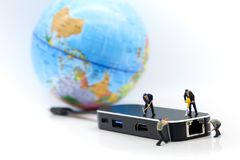 Miniature people : worker team with usb cable of globe world ma royalty free stock photos