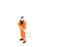 Miniature people worker wearing safety construction on white bac Stock Image