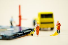 Miniature people: Workers moving circuit board for repair. Use image for support and maintenance business concept electronics stock image