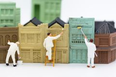 Miniature people: Workers are painting the building in town. Image use for business concept.  stock images
