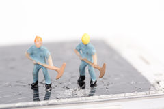 Miniature people working Stock Photography