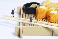 Miniature peoples with lunch Stock Images