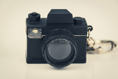 Miniature photo camera toy, photography concept, vintage filter Royalty Free Stock Images