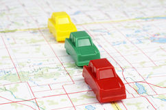 Miniature Plastic Cars On A Map Royalty Free Stock Image