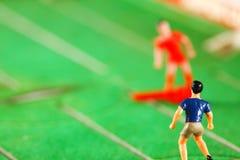 Miniature plastic figure model of soccer player. Miniature plastic figure model of soccer player represent sport concept Stock Photography