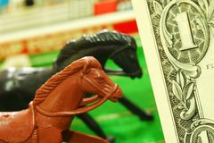 Miniature plastic horse model and money. stock photo