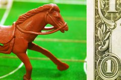 Miniature plastic horse model and money. stock photos