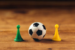 Miniature plastic soccer ball on wooden table Royalty Free Stock Image