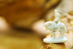 Miniature of plastic soldier on horse figure model toy. royalty free stock image