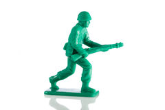 Miniature plastic toy soldier. On white background Royalty Free Stock Photos