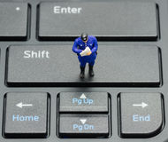 Miniature policeman on the keyboard royalty free stock images