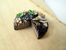 Miniature polymer clay chocolate cake on the table Stock Image