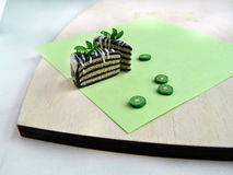 Miniature polymer clay kiwi cake on the table Royalty Free Stock Image