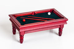 Miniature  pool table. Miniature furniture - pool table with balls and pool sticks Royalty Free Stock Photography