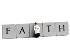Miniature priest faith Royalty Free Stock Image