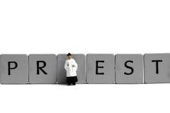 Miniature priest Stock Image