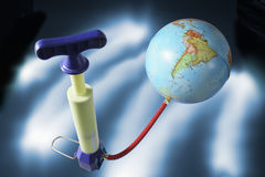 Miniature Pump Attached to Globe Stock Photography