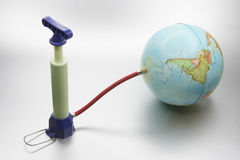 Miniature Pump Attached to Globe Royalty Free Stock Image
