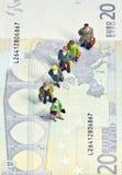 Miniature queue twenty euros. Macro shot of male and female figurines queueing on twenty euro note Stock Photography