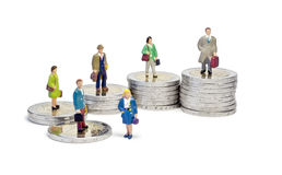 Miniature queue two euro stairs. Macro shot of male and female figurines queueing on stairs made of 2 euro coins Royalty Free Stock Image