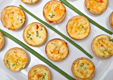 Miniature quiches on a white plate Stock Image