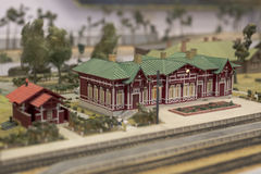 Miniature of railway station. Model of retro railroad station Stock Photos