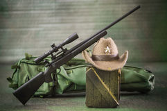 Miniature realistic hunter tools brown backgrounds Stock Image