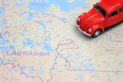 Map Of Canada Driving.Miniature Red Car Driving On A Map Of Labrador Canada Stock