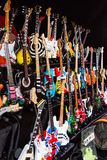 Miniature Replicas of Guitars Mythical. Since outdoor market, with handmade miniature reproductions of famous mythical guitars, made in polychrome wood Royalty Free Stock Image