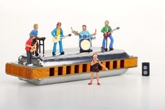 Miniature of a rock band playing on the harmonica Stock Photography