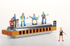 Miniature of a rock band playing on the harmonica Royalty Free Stock Images
