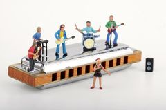 Miniature of a rock band playing on the harmonica Royalty Free Stock Photos