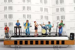 Miniature of a rock band playing on the harmonica Stock Photos