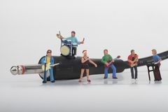 Miniature of a rock band playing on the harmonica Stock Image