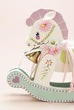 Miniature Rocking Horse. On warm background Royalty Free Stock Image
