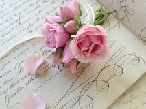 Miniature rose bouquet on 18th century page Stock Photography